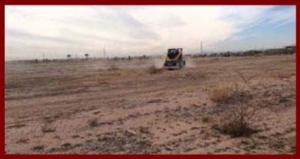 Tractor tilling land